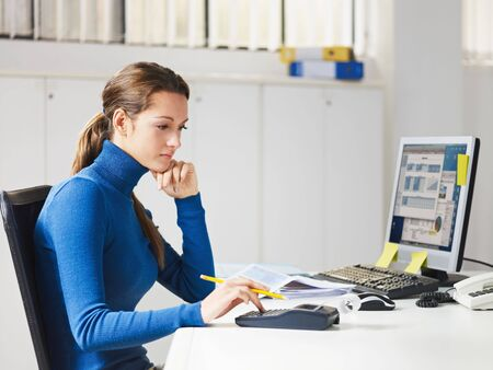 woman typing: portrait of business woman typing on calculator