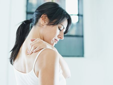 human neck: woman massaging neck. Side view, copy space Stock Photo
