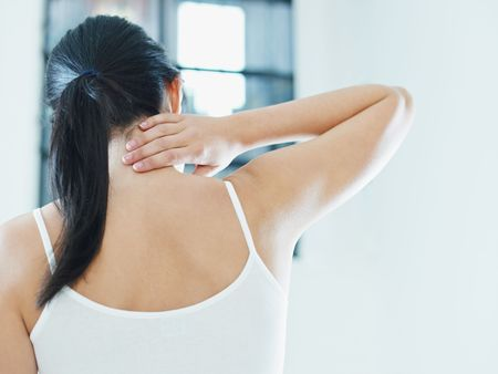 woman massaging neck. Rear view, copy space photo