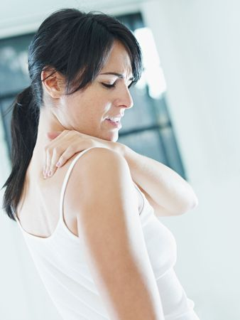 strained: woman massaging neck. Side view, copy space Stock Photo