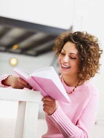 woman reading book at home. Copy space Stock Photo - 6156099