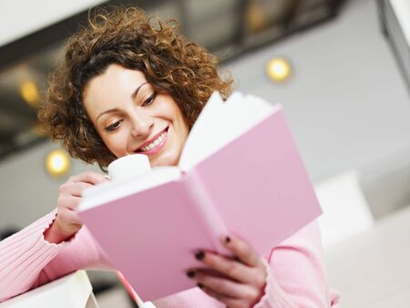 woman reading book at home and drinking coffee. Copy space Stock Photo - 6156101
