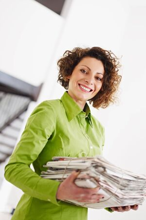 woman holding newspapers for recycling. Copy space Stock Photo - 6171895