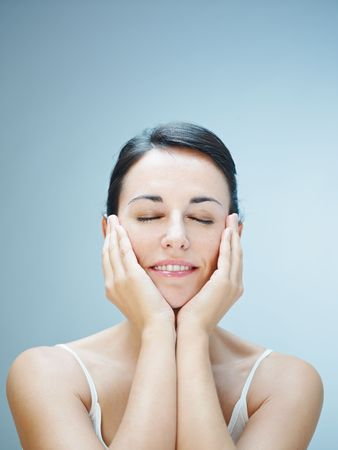 close up of woman touching chins. Copy space Stock Photo - 6227594