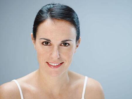 mid adult woman looking at camera. Copy space Stock Photo - 6242985