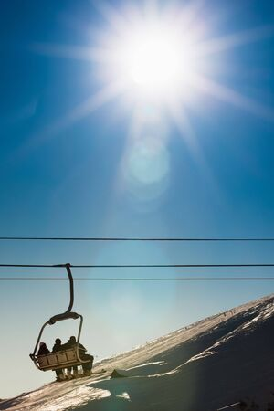group of people on chairlift in France. Copy space photo