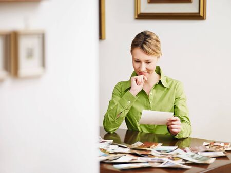 albums: woman looking at pictures. Copy space Stock Photo