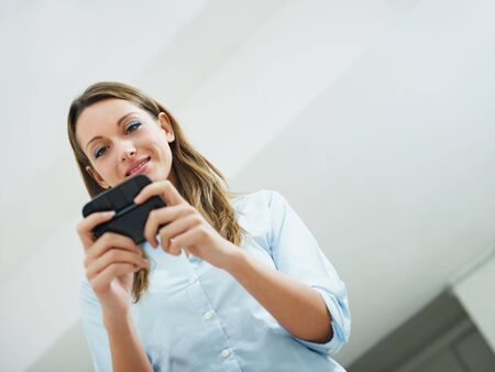 woman reading emails on mobile phone. Copy space Stock Photo - 6275391