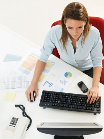 business woman in office using desktop computer. Copy space Stock Photo - 6275390