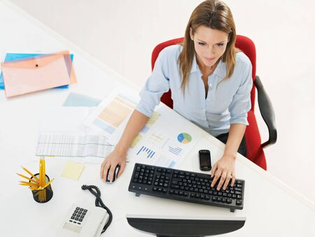 business woman in office using desktop computer. photo