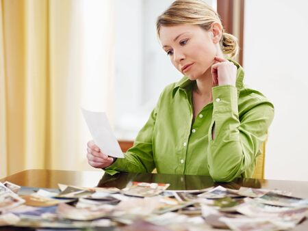 holding the head: woman looking at pictures. Copy space Stock Photo