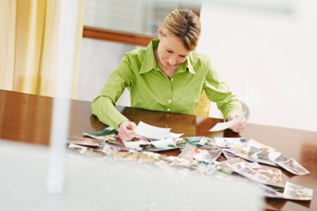 woman looking at pictures. Copy space photo