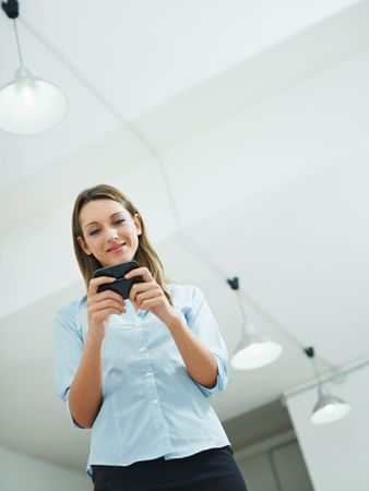 woman reading emails on mobile phone. Copy space photo