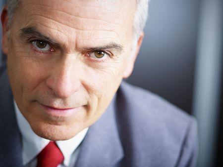 copyspace corporate: closeup of mature business man looking at camera. Copy space
