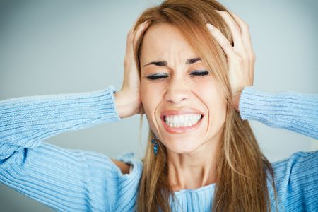 stressed mid adult woman covering ears with hands and screaming. Horizontal shape, Copy space Stock Photo - 6463355