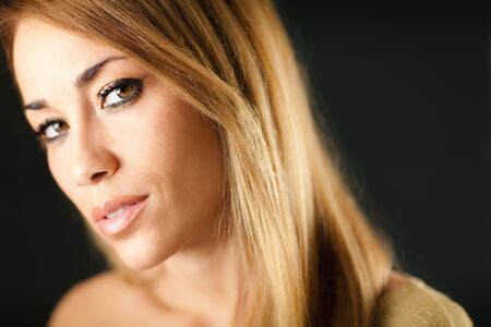 portrait of beautiful woman on black background, looking at camera. Horizontal shape, copy space Stock Photo - 6463358