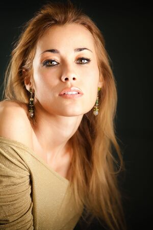 portrait of beautiful woman on black background, looking at camera. Vertical shape Stock Photo - 6507441