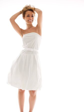 mid adult woman in white dress, looking at camera on white background. Vertical shape, copy space Stock Photo - 6536034
