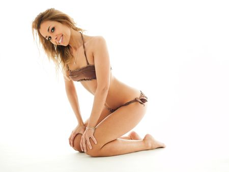 mid adult woman in bikini, looking at camera on white background and smiling. Horizontal shape, copy space Stock Photo - 6562786