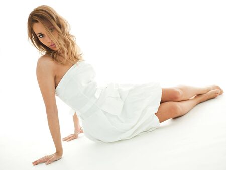 mid adult woman in white dress, looking at camera on white background. Horizontal shape, copy space Stock Photo - 6602933