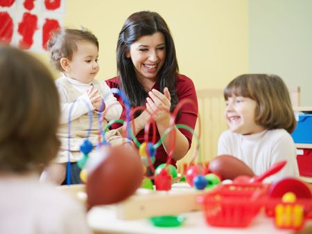 baby girl playing: female toddler and 2-3 years girls playing with toys in kindergarten. Horizontal shape Stock Photo