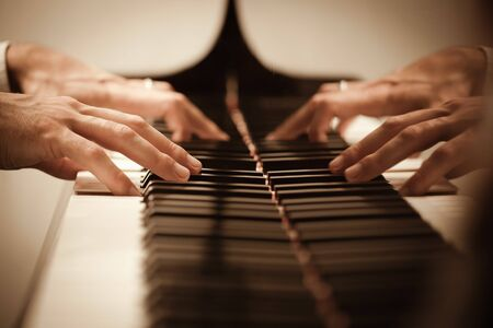 close up of male hands playing piano. Horizontal shape, copy space photo