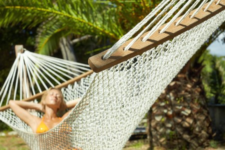woman relaxing on hammock with eyes closed. Front view, horizontal shape, focus on foreground Stock Photo - 7792111