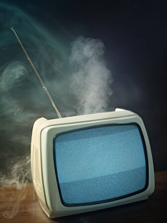 broken tv about to explode. Studio shot, vertical shape, copy space photo