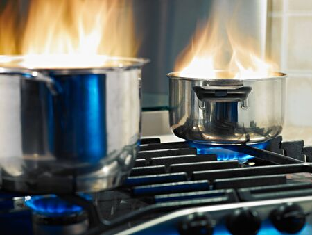 pans in fire on stoves. Horizontal shape Stock Photo - 7939245