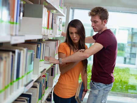 waist up: two caucasian students leaving each other. Horizontal shape, side view, waist up Stock Photo