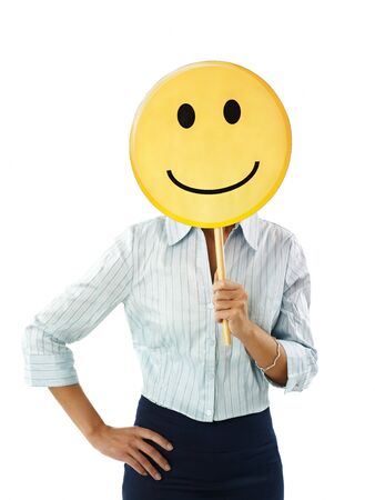 waist up: adult business woman holding smiley emoticon on white background. Vertical shape, front view, waist up
