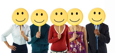 waist up: multiethnic group of people holding smiley emoticons on white background. Horizontal shape, front view, waist up