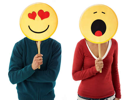 young adult woman and man holding emoticons on white background. Horizontal shape, front view, waist up Stock Photo - 8324110