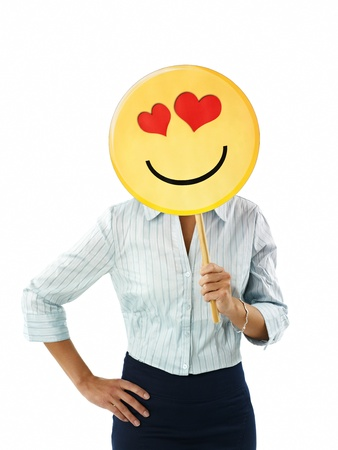 waist up: adult business woman holding emoticon with red hearts on white background. Vertical shape, front view, waist up Stock Photo