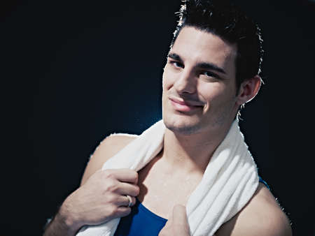 portrait of confident caucasian male in sportswear, looking at camera and smiling on black background. Horizontal shape, head and shoulders, copy space Stock Photo - 8843308