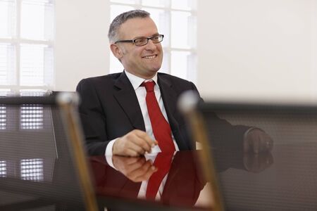 one on one meeting: Portrait of caucasian mid adult business man talking to colleagues in meeting room. Horizontal shape, side view, copy space