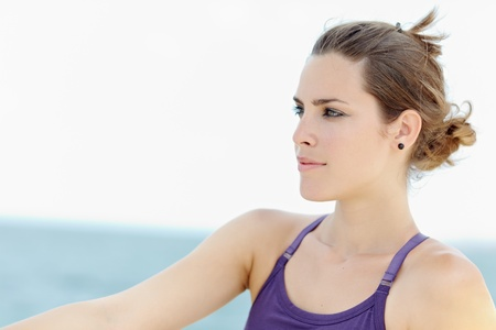 portrait of young caucasian woman looking away near the sea. Horizontal shape, head and shoulders, copy space Stock Photo - 9481614
