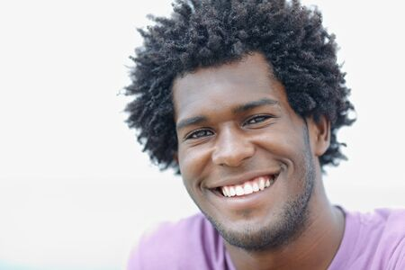 portrait of young african american guy looking at camera near the sea. Horizontal shape, head and shoulders, copy space Stock Photo - 9481616