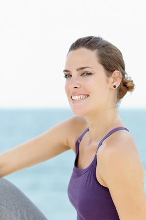 portrait of young caucasian woman looking at camera near the sea. Horizontal shape, waist up, copy space Stock Photo - 9481617