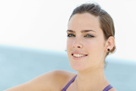 portrait of young caucasian woman looking at camera near the sea. Horizontal shape, head and shoulders, copy space Stock Photo - 9481618