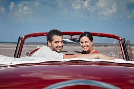 havana cuba: boyfriend and girlfriend sitting in vintage car and hugging in havana, cuba. Horizontal shape, side view, copy space