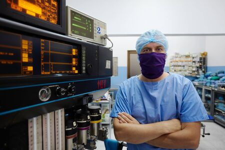 Portrait of caucasian doctor looking at camera in hospital surgery room with professional equipment and instruments Stock Photo - 12943205
