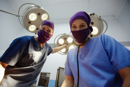 Teamwork with nurse and surgeon performing surgery in hospital operation room photo