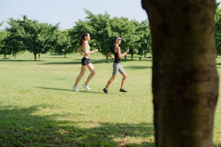 Sports and fitness with two female teenagers exercising in city park photo