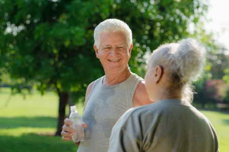 Senior people, old man and woman talking and drinking water after exercising in park Stock Photo - 14122304