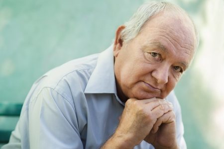 depression: Seniors portrait of contemplative old caucasian man looking at camera. Stock Photo