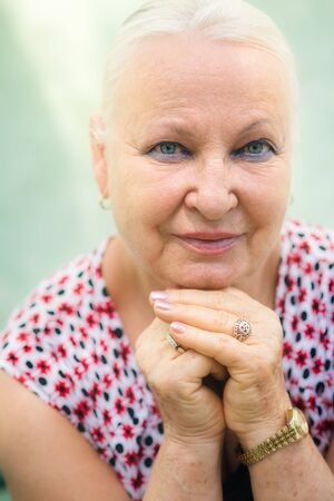 Portrait of senior caucasian woman looking at camera and smiling photo