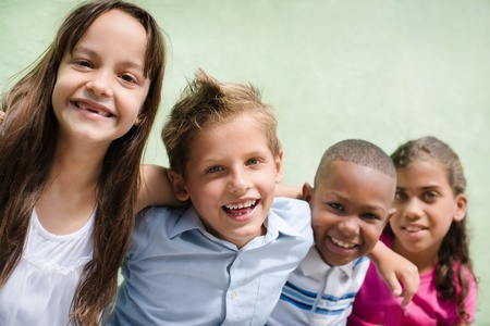 buddies: Group of happy children smiling, embracing and looking at camera. Copy space Stock Photo