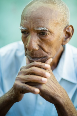 Seniors portrait of contemplative old african american man looking away. Copy space photo