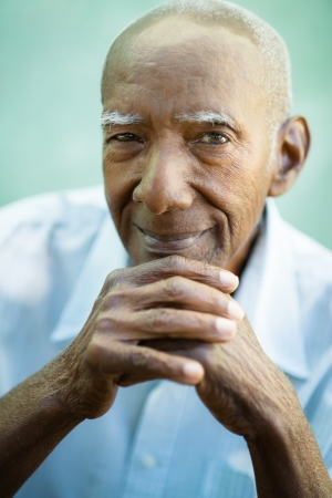Portrait of happy senior hispanic man looking at camera and smiling photo